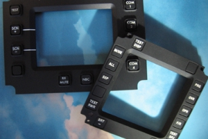NVG Compatible Integrated Tactile Switch Panels and Bezels